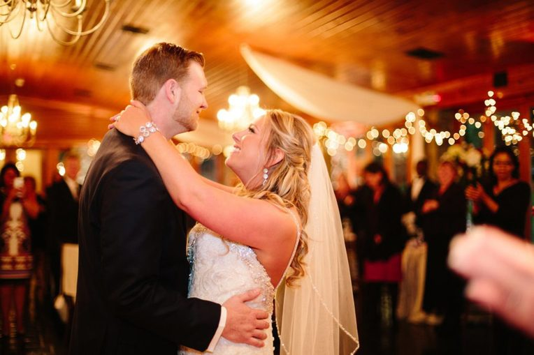 bride and groom dance their first dance under twinkling lights at stroudsmoor country inn